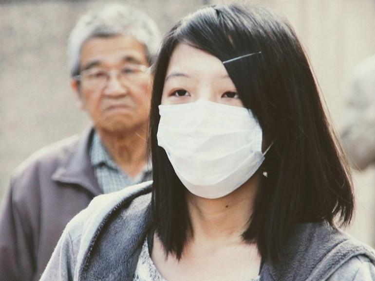 Primavalle Epidemic fase 4: donna cinese con mascherina